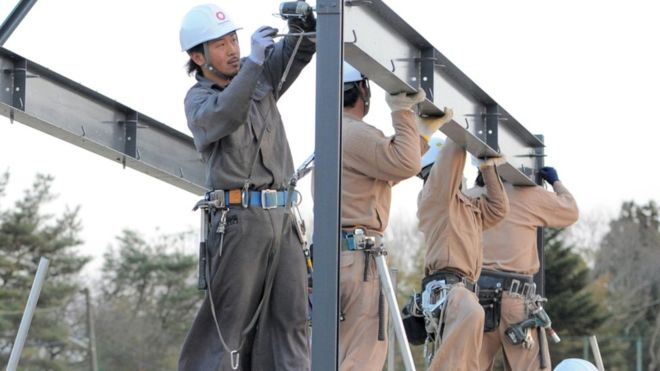 Japan eases immigration rules for workers