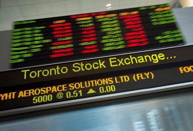 Stocks up loonie down