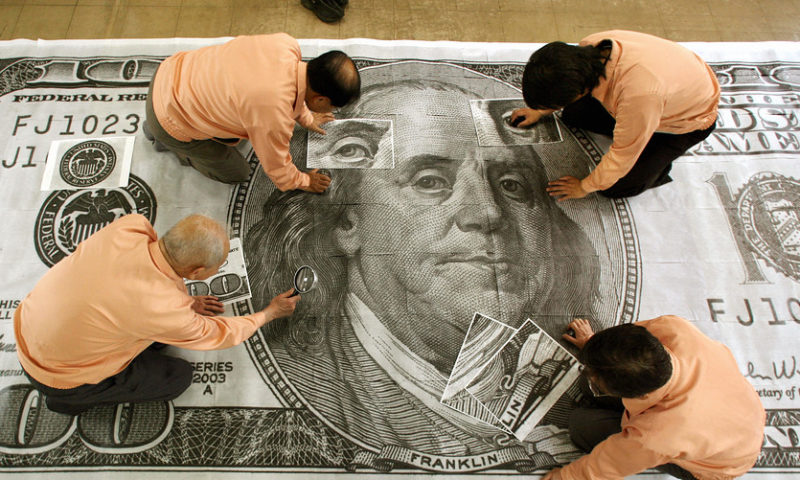 Dollar heads lower at start of busy central bank policy week