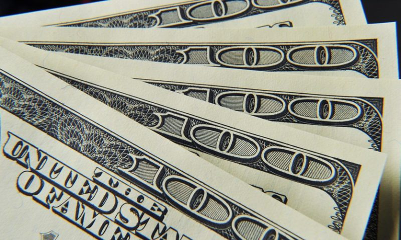 Dollar skids lower ahead of expected Fed policy decision