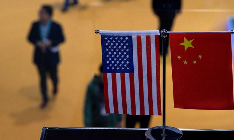 Dow closes down 800 points as U.S.-China trade, flattening yield curve spook investors
