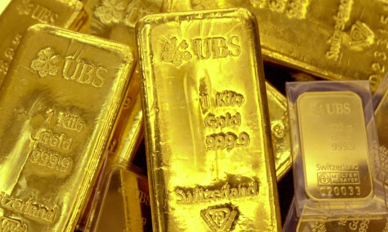 Gold prices finish lower after failing to reach $1,300 an ounce