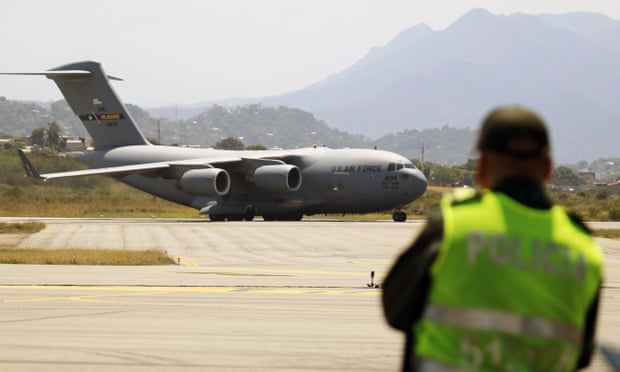 US aid for Venezuela arrives in Colombia, but delivery uncertain