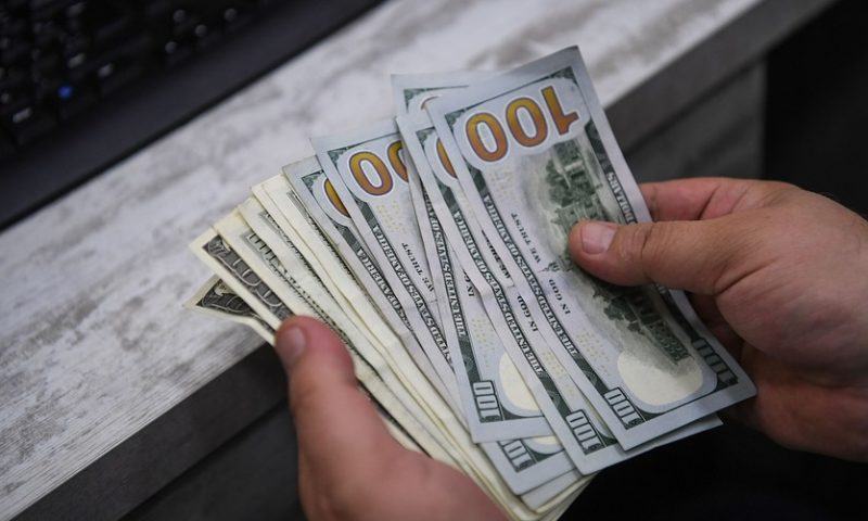 Dollar climbs, amid Trump's fresh calls for weaker currency, dovish Fed