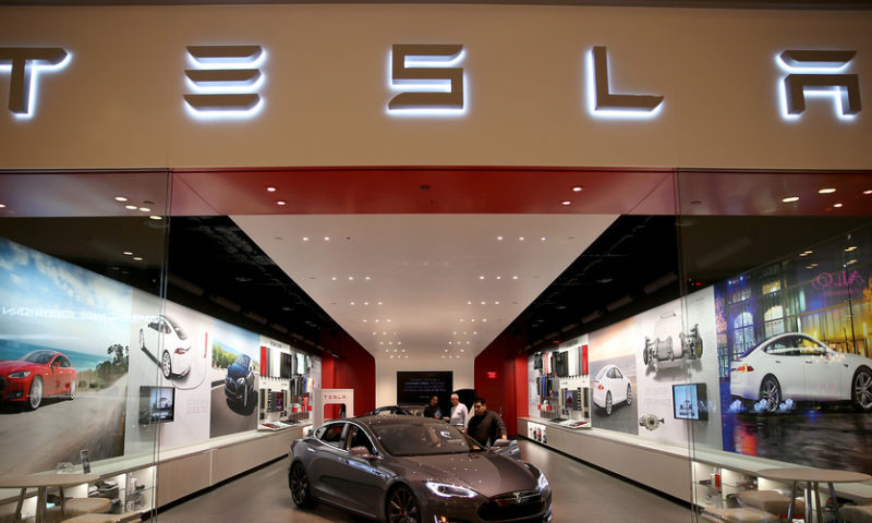 Tesla shares rise after company reverses decision to close all stores