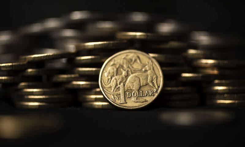 Dollar holds near multimonth high; Aussie crashes on benign inflation