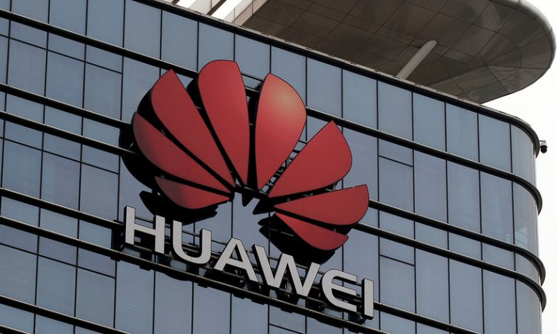 Asian markets mixed as investors weigh Huawei implications