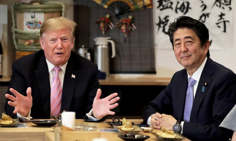 Asian markets mixed as Trump visits Japan