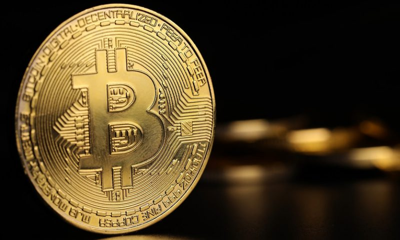 Bitcoin tops $9,000 level for first time in 13 months