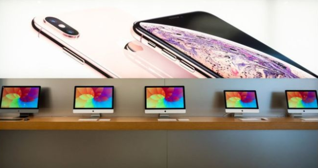 Apple sales rise while iPhone revenues dip
