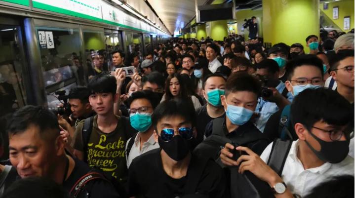 Hong Kong protesters disrupt morning subway service