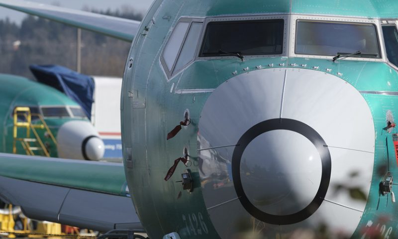 Dow closes at record after Boeing surges on report of 737 Max early return
