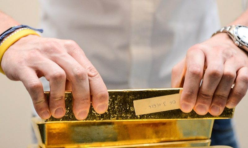 Gold settles at 4-month high as Middle East tensions drive haven buying