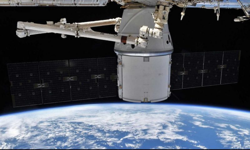 SpaceX Dragon spacecraft caught by robotic space station arm for the last time