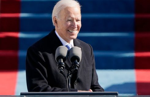 U.S. stocks finish at fresh highs as Biden begins presidency with vow of unity