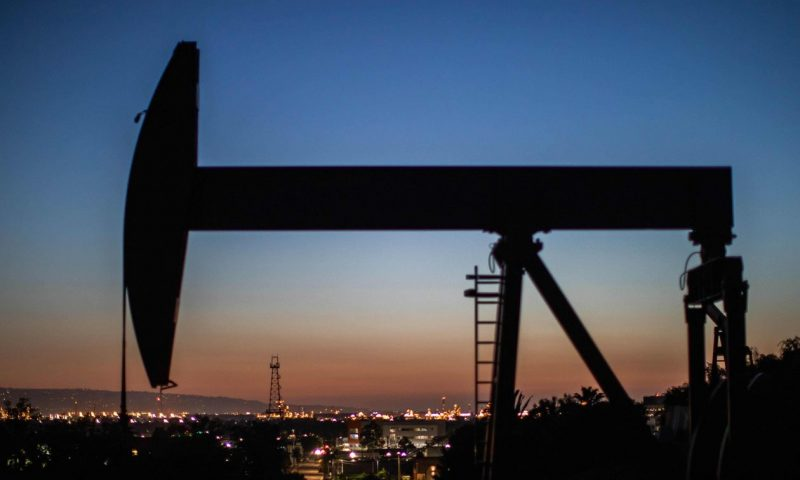 Oil ends higher, with U.S. prices back above $70 a barrel