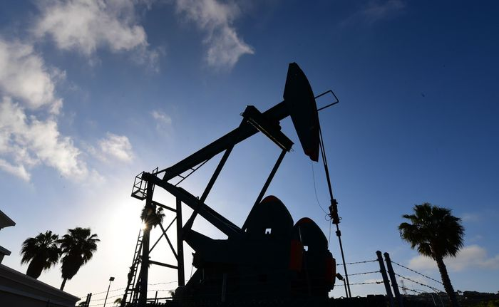 Oil futures settle at their lowest in nearly a month