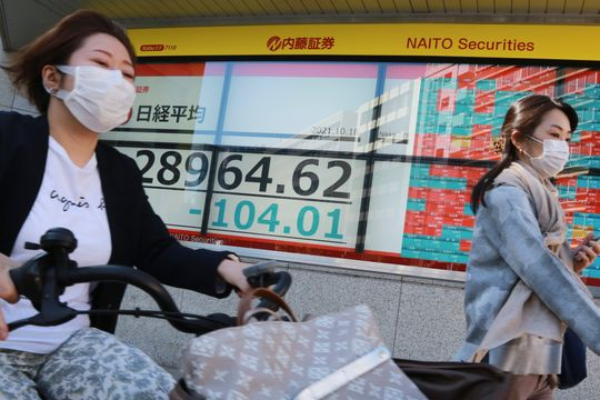 Asian shares under pressure after China growth falls short of expectations